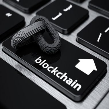 Image of a computer keyboard with a blockchain icon - representing how this emerging technology looks set to transform the property industry in the UK and across the globe.
